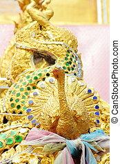 peacock statue in thai temple