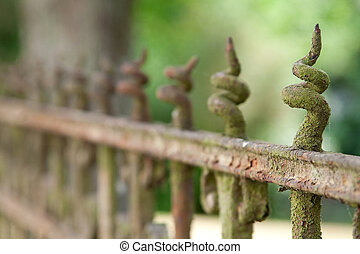 peaked fence - a peaked old fence with rust