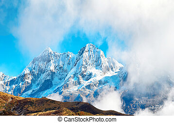 Peaks of mountains, covered by snow.