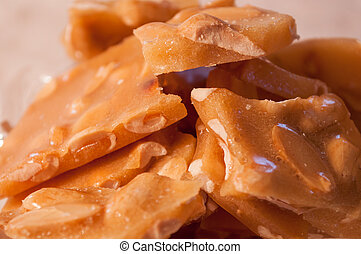 peanut brittle close up - isolated close up of pieces of...