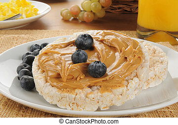 Peanut butter and blueberries on rice cakes