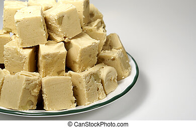 a plate with homemade peanut butter fudge