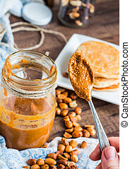 peanut butter in a jar, eat a teaspoon and pancakes