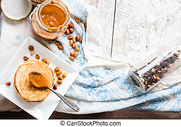peanut butter in a jar, top view and place for text