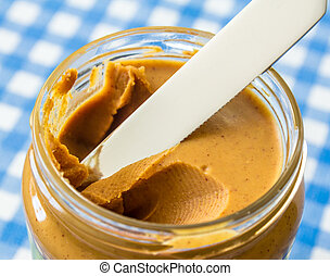 peanut butter in a jar with knife