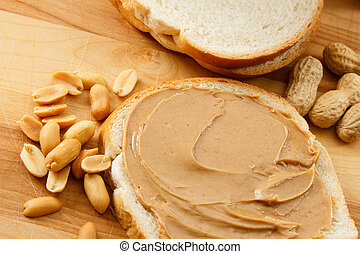 Peanut Butter on Bread with Peanuts - Peanut Butter and...