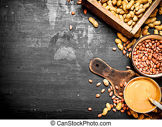 Peanut butter with nuts in a bowl.