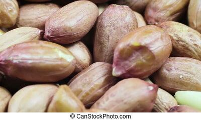 Peanut in the Skin Rotating - Peanut rotates on the table....