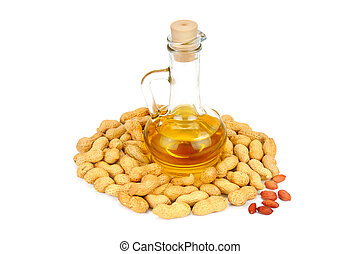 Peanuts and oil in bottle isolated on white background.