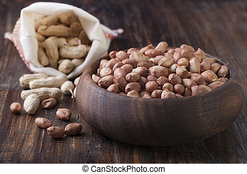 Peanuts in a wooden bowl