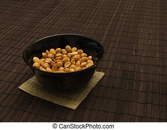 peanuts in black can
