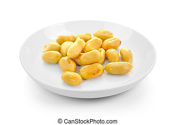 peanuts in plate on white background