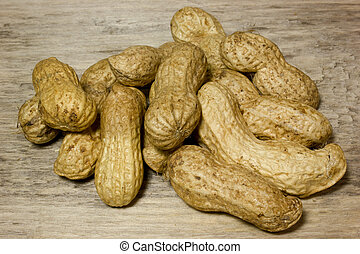 Peanuts in shell on wooden background