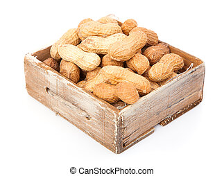 Peanuts in the old box, on white background