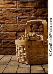 peanuts in wooden basket