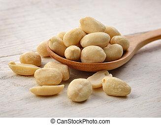 Peanuts in wooden spoon