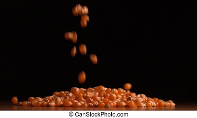 Peanuts pouring on black background
