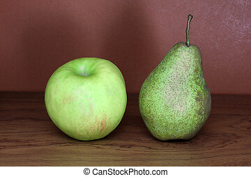 Pear and apple on a wooden background