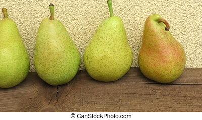 Pear autumn harvest. Fresh organic pears on wooden plank.