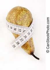 pear with a measuring tape