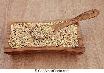 Pearl Barley - Pearl barley in an olive wood bowl with spoon...