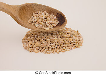 Pearl barley with wooden spoon isolated on white background