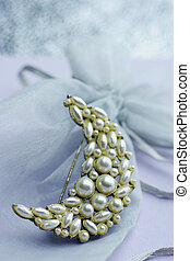 pearl brooch with golden glow