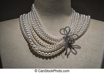 Pearl luxury necklace with precious stones in white golden ...