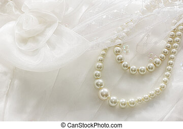 Pearl necklace on lace background.