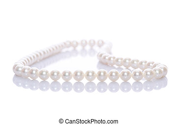 Pearl Necklace - Pearl necklace with reflection on white...