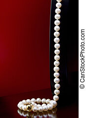 Pearl necklace - Necklace of natural pearls on the table on...