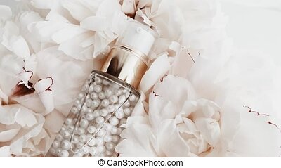 Pearl primer and make-up base in granules with peony flowers...