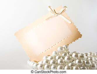 Pearl with card isolated on white