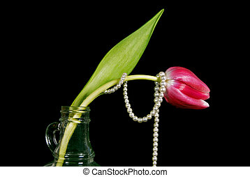 pearl wrapped tulip - Strand of pearls wrapped around a...