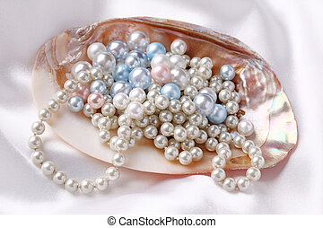 Pearls in a shell on a white silk
