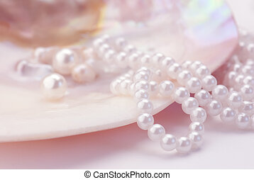 Pearls - Macro of pearls and necklace in an oyster shell. ...