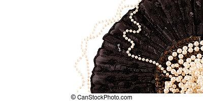 pearls on a black fan