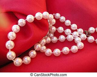 pearls on a cushion