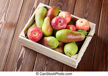 Pears and apples in wooden box