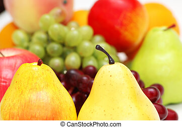 Pears and other fruits at the background