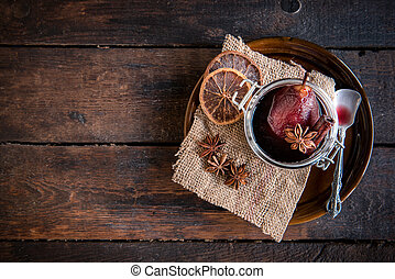 Pears in the wine - Served cooked pears in wine on wooden...
