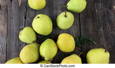 Pears on old wooden background, vertical composition