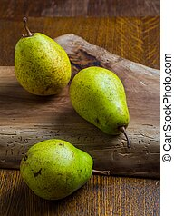 Pears on wooden cutting board