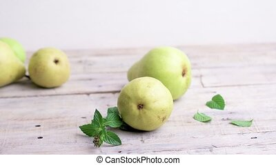 Pears on wooden table - Pears scattered on a white wooden...