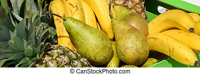 pears pineapples bananas in a wooden box