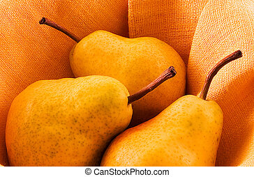 Three pears in warm light