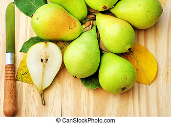 pears with knife on the wooden table
