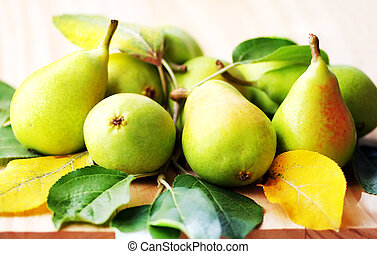 pears with leaves on the wooden table