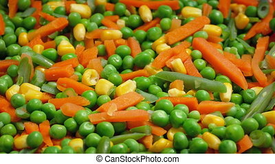 Peas And Carrots Mixture Closeup - Cooked vegetable mixture...