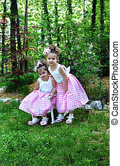 Peas in a Pod - Sisters lean close together to model their ...